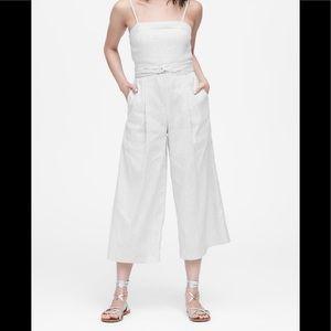 Stripe linen-cotton jumpsuit.
